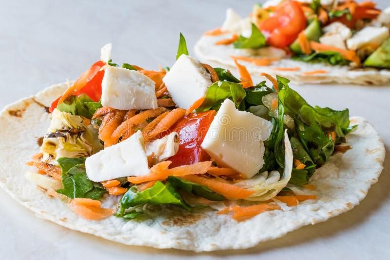 Homemade Vegetarian Tostadas with Salad, Cheese and Grated Carrot Slices. stock photos