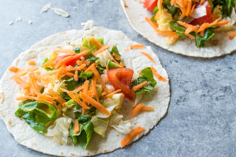 Homemade Vegetarian Tostadas with Salad and Polished Carrot Slices. stock photo