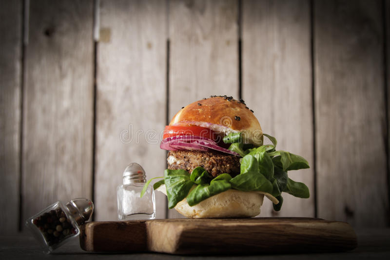 homemade veggie burger in a bun sesame seeds of beer. stock photos