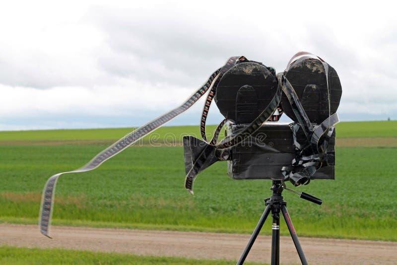 Homemade Vintage Videocamera Spewing Film. Homemade Vintage Videocamera on a Tripod Spewing Film stock photos