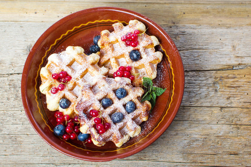 Homemade waffles with fresh berry fruit royalty free stock images