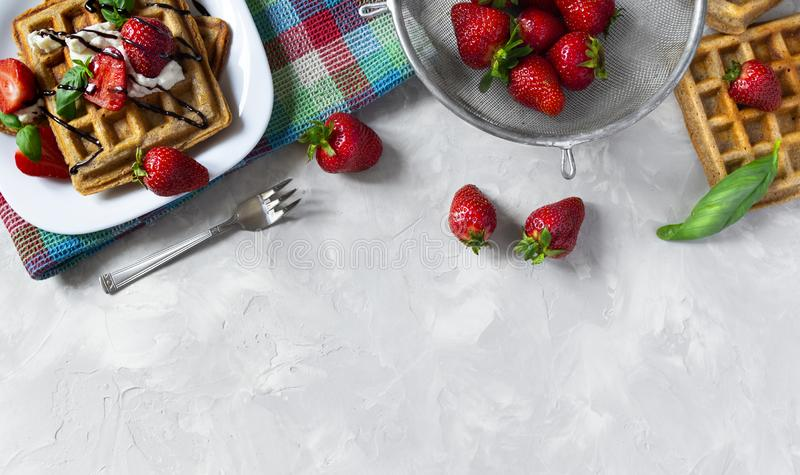 Homemade waffles with strawberries, ricotta cheese and chocolate on white plate. Flat lay, copy space. Homemade square Belgian waffles with strawberries, ricotta stock images