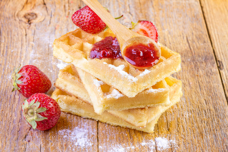 Homemade waffles with strawberry jam royalty free stock image