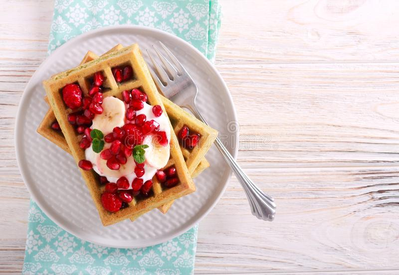 Homemade waffles with yogurt and berries royalty free stock photos
