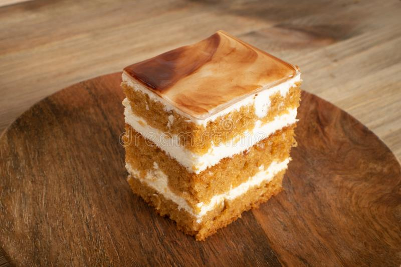 Homemade Wet Sponge Cake on Wooden Plate royalty free stock photography