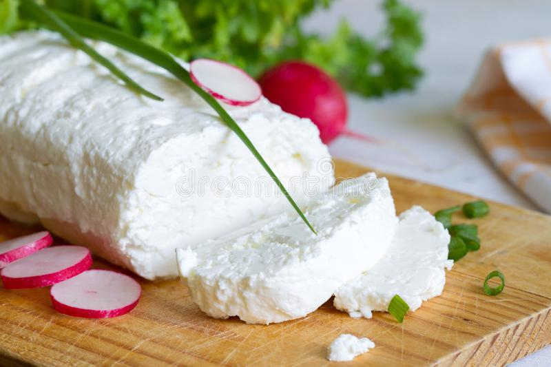 Homemade white cottage cheese on wooden table. Closeup stock image