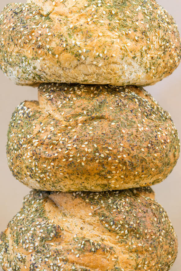 Homemade, whole grain artisan bread on top of each other stock photos