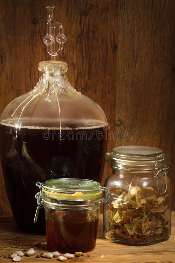 Homemade wine in basement with honey stock photos
