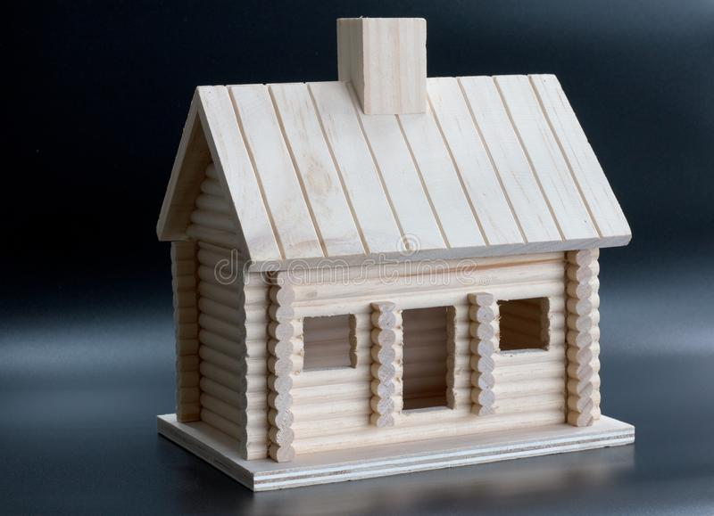 Homemade wooden house on a black background royalty free stock image
