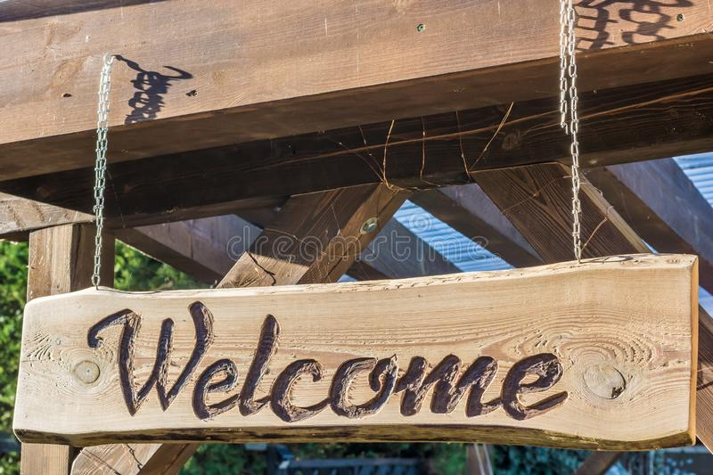 Homemade inviting wooden sign with the inscription Welcome royalty free stock photography