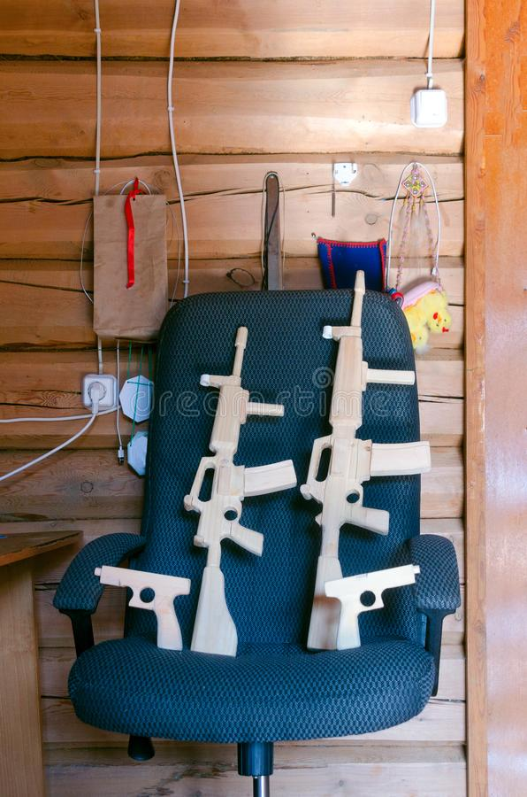 A homemade wooden weapon two submachine guns and pistols for children to play carved from boards. A homemade wooden weapon two submachine guns and pistols for royalty free stock photography