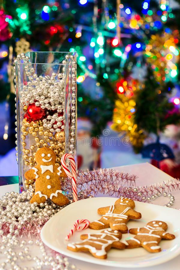 Homemade Xmas Cookies Gingerbread Man. Blurred light new year tree background. Christmas composition. Selective focus. royalty free stock photos