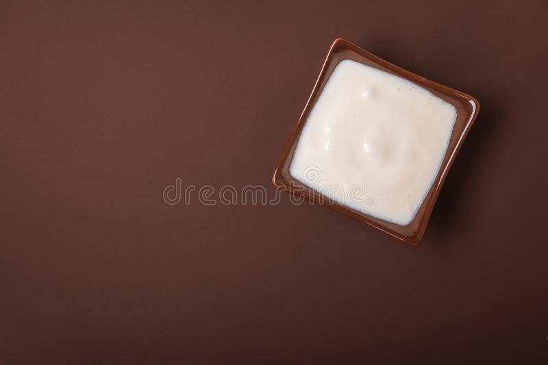 Homemade yogurt in a ceramic square bowl. Healthy food from the concept of yogurt. Top view.  royalty free stock photo
