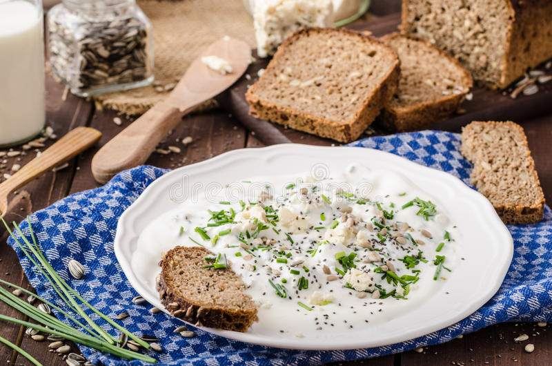 Homemade yogurt dip with blue cheese and chives. Whole wheat bread and milk for bio healthy food stock image