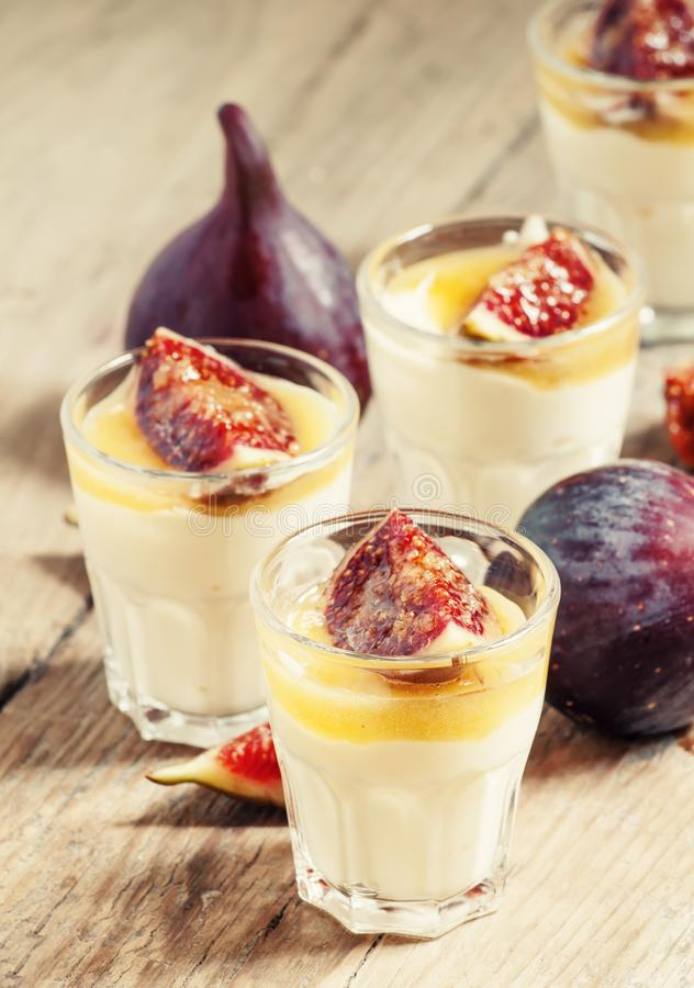 Homemade yogurt with figs and honey, selective focus royalty free stock images