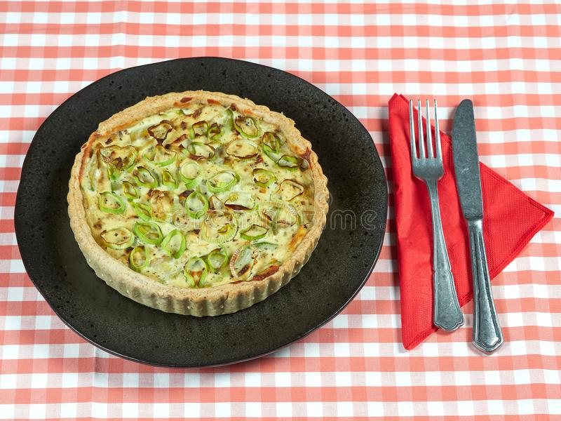 Homemade zucchini, leek and ricotta quiche royalty free stock image
