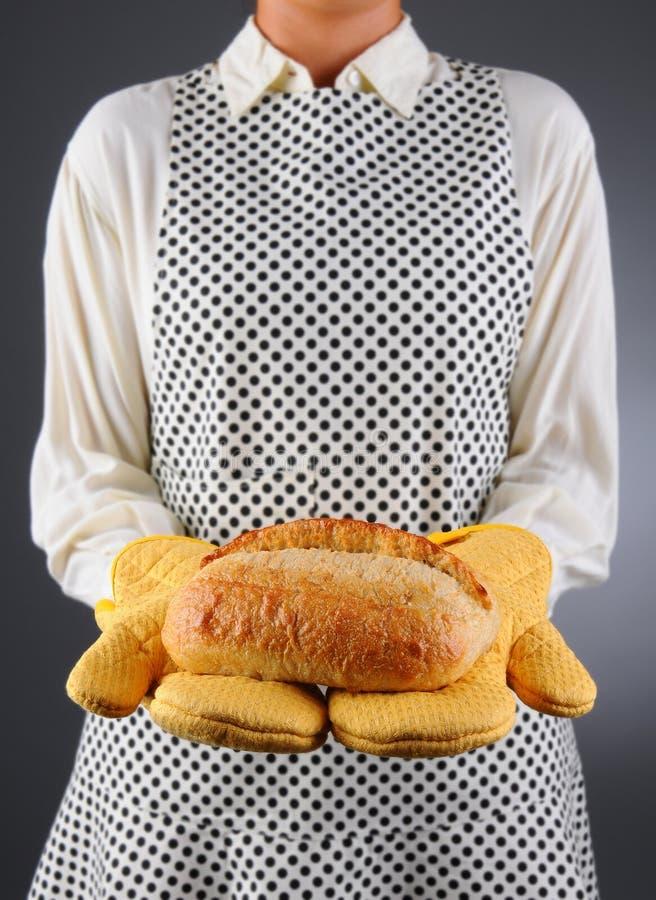 Download Homemaker Holding Fresh Loaf Of Bread Stock Image - Image: 26070231