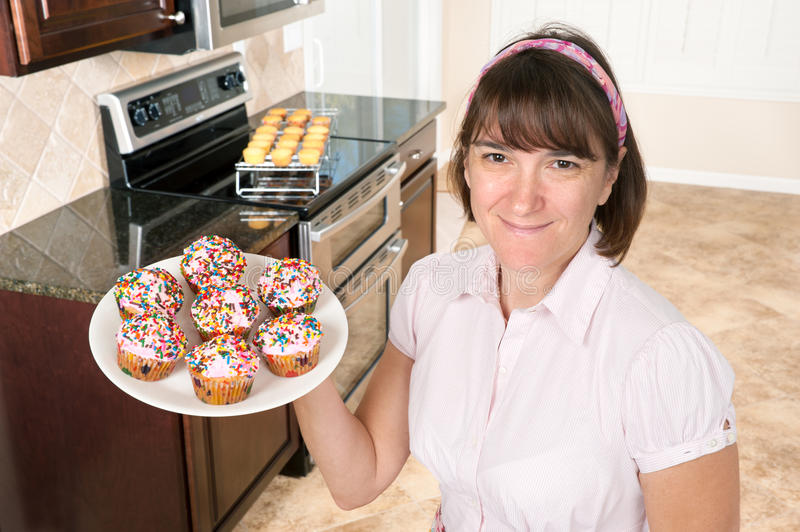 Download Homemaker Holding Plate Of Cupcakes Royalty Free Stock Photos - Image: 17473908