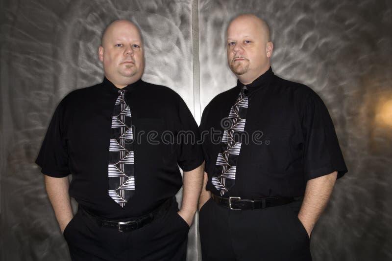 Homens calvos gêmeos. fotos de stock royalty free