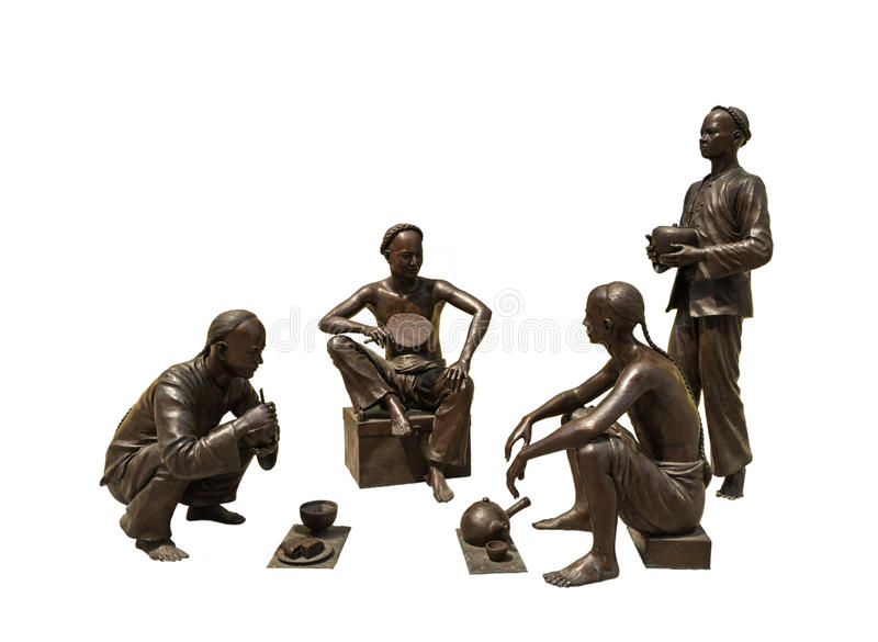 Homens chineses de bronze isolados no fundo branco fotos de stock royalty free