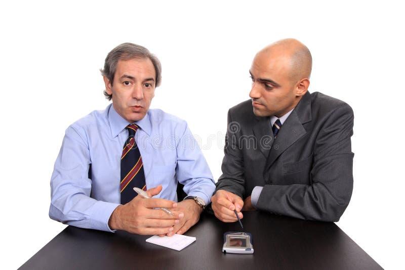 Homens de negócio em uma reunião foto de stock