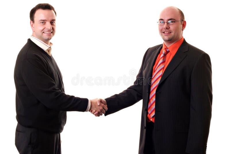 Homens de negócio que agitam as mãos fotografia de stock royalty free