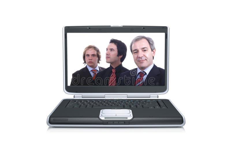 Homens de negócios dentro de uma tela preta do portátil foto de stock royalty free