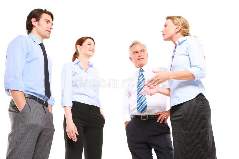 Homens de negócios e fala das mulheres de negócios fotografia de stock