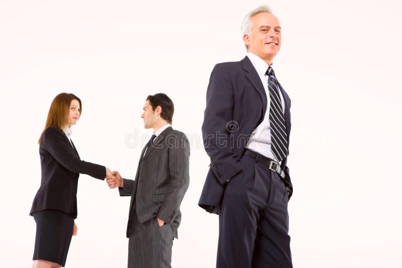 Homens de negócios e mulher de negócios fotos de stock