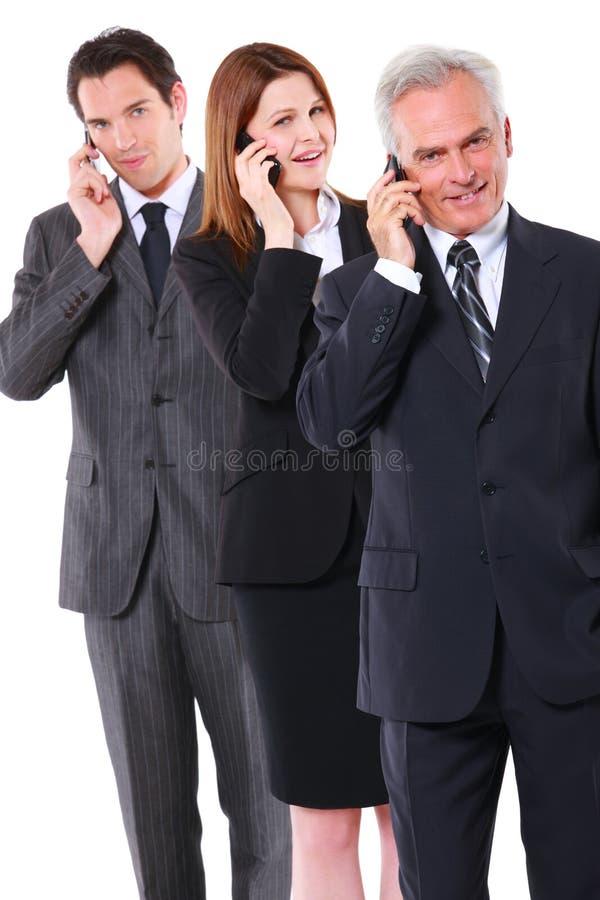Homens de negócios e mulher de negócios imagem de stock