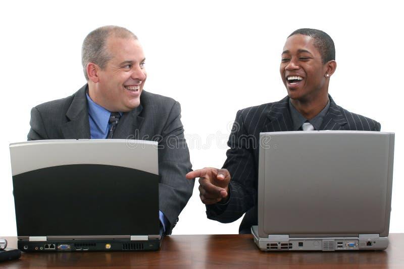 Homens de negócios que trabalham junto fotos de stock royalty free