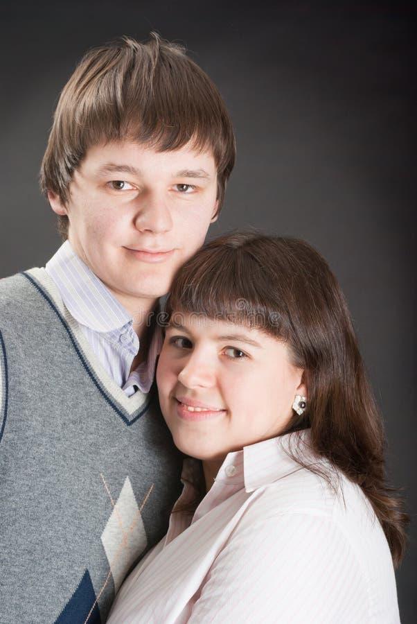 Homens e mulheres bonitos do retrato fotografia de stock