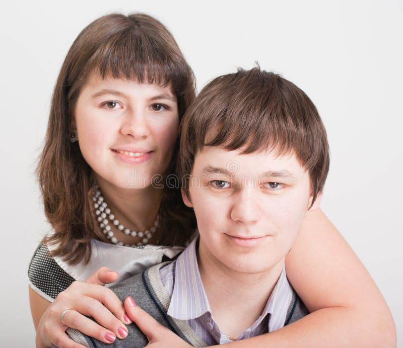 Homens e mulheres bonitos do retrato fotos de stock royalty free