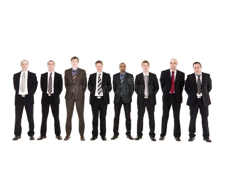 Homens em uma fileira foto de stock