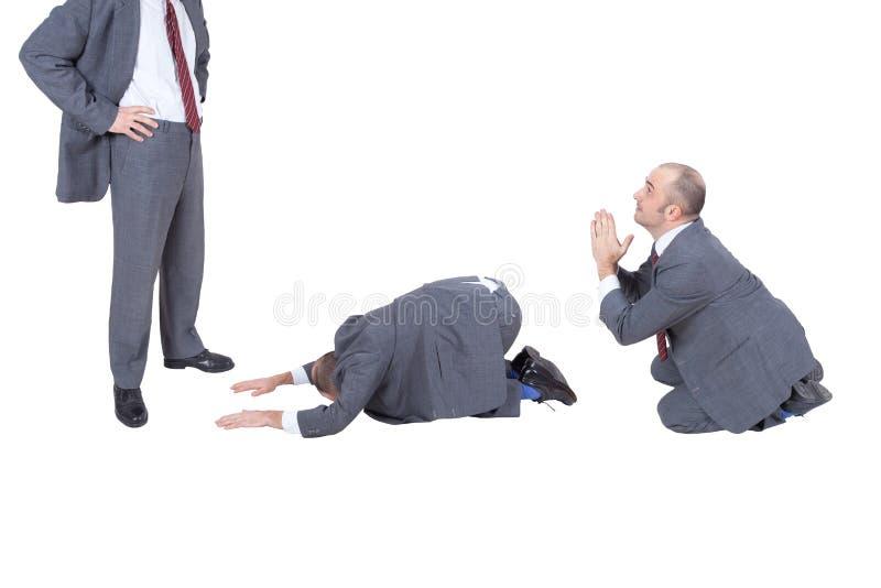 Homens de negócios que imploram seu chefe foto de stock royalty free