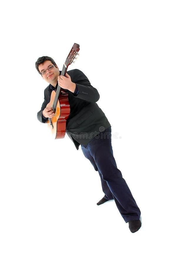 Homens que jogam a guitarra acústica imagens de stock royalty free