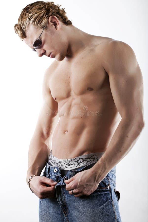 Homens 'sexy' nas calças de brim fotografia de stock