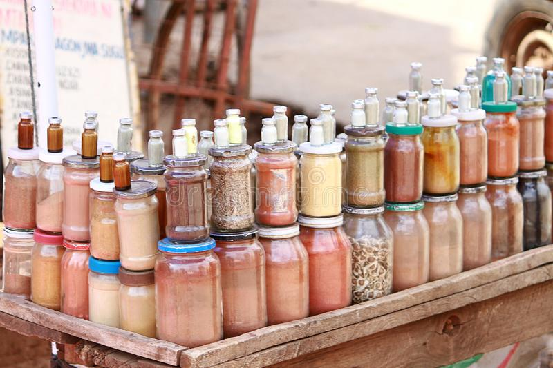 Homeopathic spices at a makeshift stall at a market in Accra, Ghana. Made from tree bark and animal organs and snake skin and other indigenous items royalty free stock image