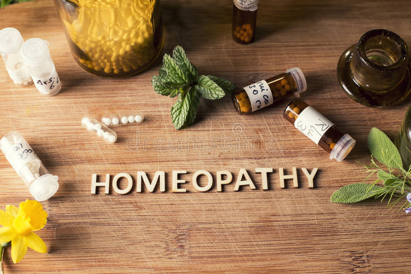 Homeopathy globules and bottles royalty free stock photos