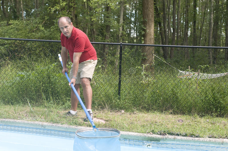 Homeowner Cleaning Swimming Pool Stock Photography