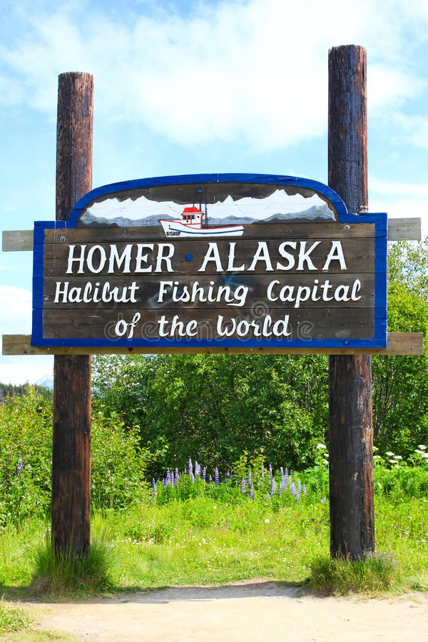 Homer Alaska - Welcome. This sign greets visitors on the Kenai Peninsula as they enter world famous Homer, Alaska, also known as the Halibut Fishing Capital of stock photo