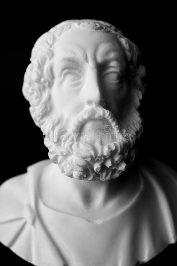 Homer is the author of the poems, Iliad and Odyssey known as. Homeric Epics. White marble bust of the greek poet royalty free stock photos