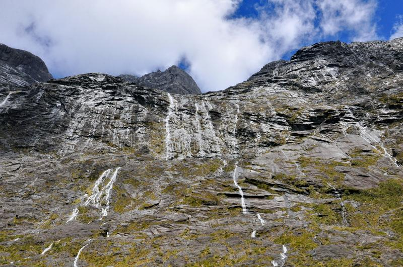 Homer tunnel under Darran Mountain på den Milford Sound huvudvägen royaltyfria bilder
