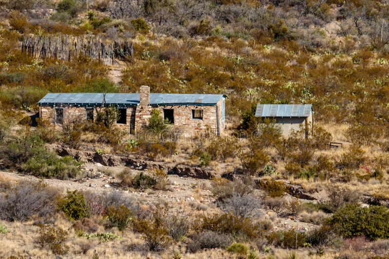 Homer Wilson Cabin in Big Bend National Park. Homer Wilson Ranch cabin located in desert mountains located in Big Bend National Park. Old corral in the back area stock image