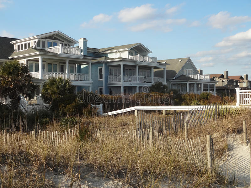 Homes along Wrightsville Beach North Carolina. Homes tucked away behind sea grass and fencing along Wrightsville Beach at dusk. Wrightsville Beach is just royalty free stock photography