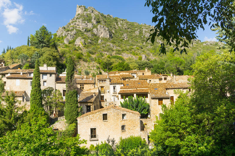 Homes and architecture in valley village historic Southern French Historic Southern French village St Guilheme Le Desert. Homes and architecture amongst the stock photography