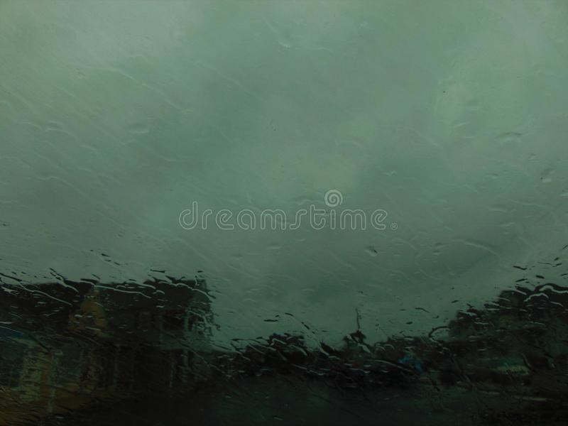Homes Barely Visible Through Rain. The outline of homes are barely visible through a slick downpour of rain; weather; early Spring 2018; Ocean City, New Jersey royalty free stock images