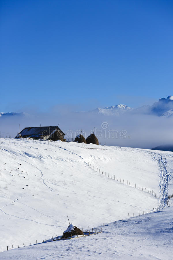Homes in the mountains in winter stock photography