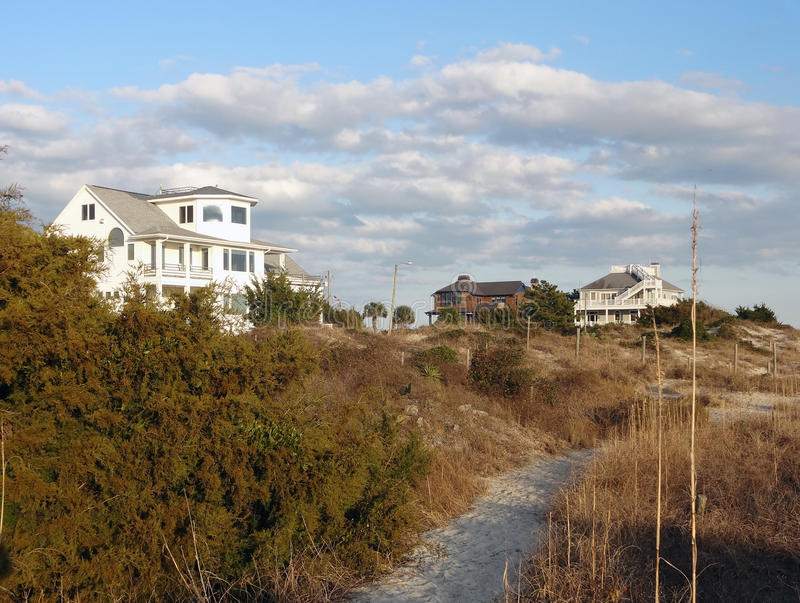 Homes on Wrightsville Beach, North Carolina. Beautiful homes along a path on Wrightsville Beach, North Carolina shot at sunset. Wrightsville Beach is just royalty free stock images