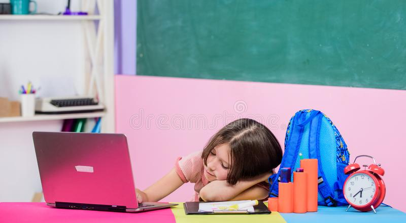 Homeschooling concept. Good morning. back to school. Online education. study online. Lesson alarm. sleepy small girl. Pupil with computer. Use new technology royalty free stock photos